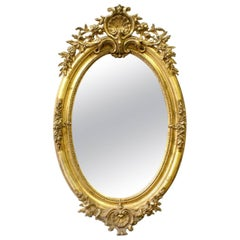 Late 19th Century Oval Louis XVI Style Giltwood Mirror