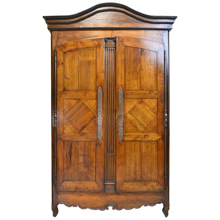 Early 19th Century Country French Armoire in Solid Walnut with Arched Bonnet