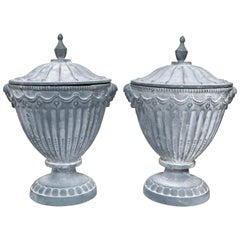 Pair of Covered Neoclassic Iron Garden Urns