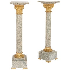 Pair of Neoclassical Style Green and White Marble and Ormolu-Mounted Pedestals