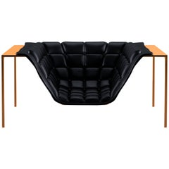Contemporary Orbital Armchair with Leather Upholstery