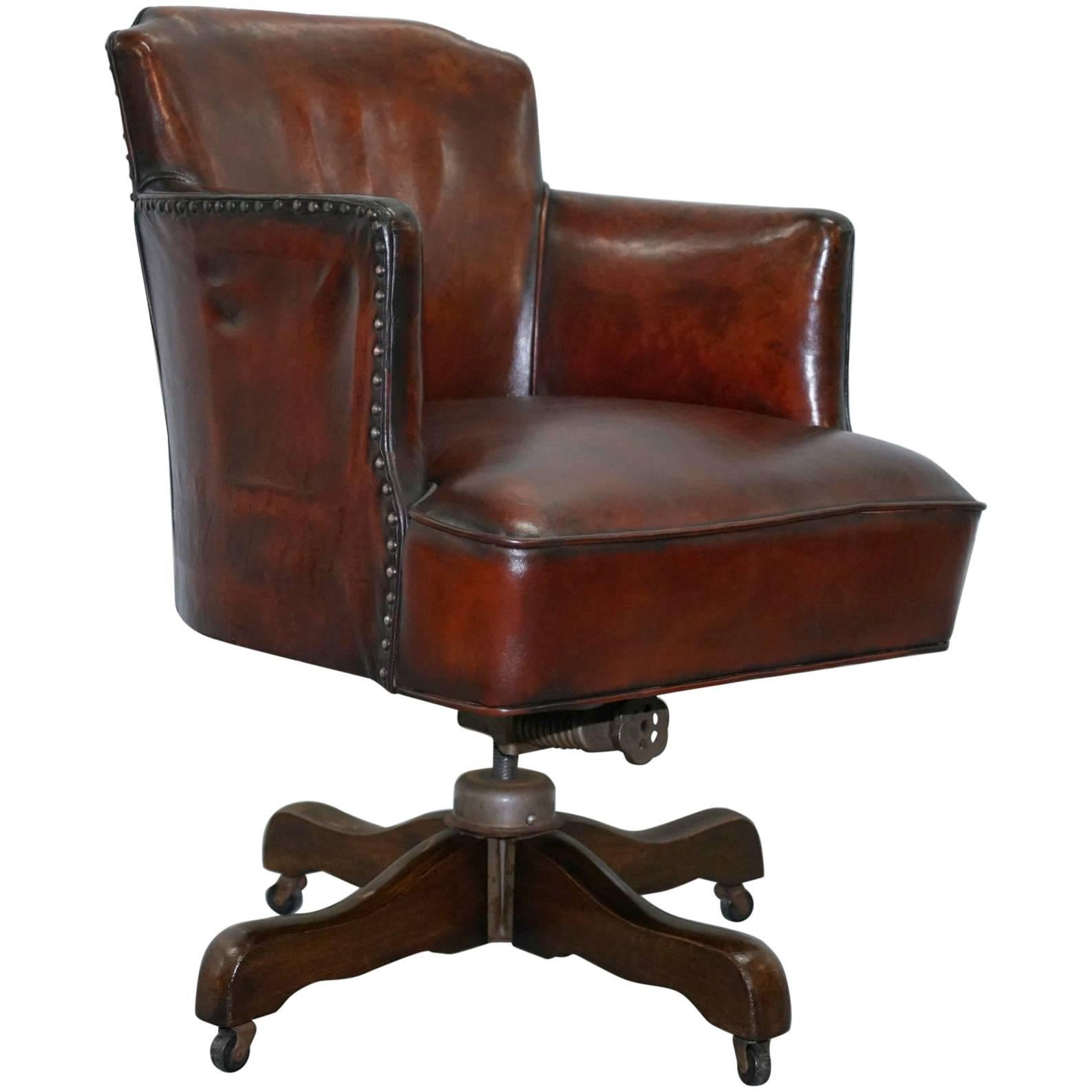 Fully Restored 1920s Hillcrest Antique Whisky Brown Leather Captains Chair  For Sale