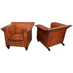 Pair of European Art Deco Even-Arm Club Chairs in Caramel Leather