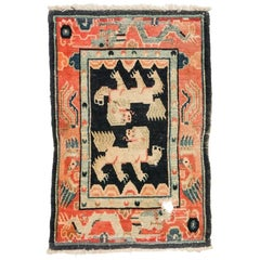 Antique Tibetan Double Snow Lion Rug