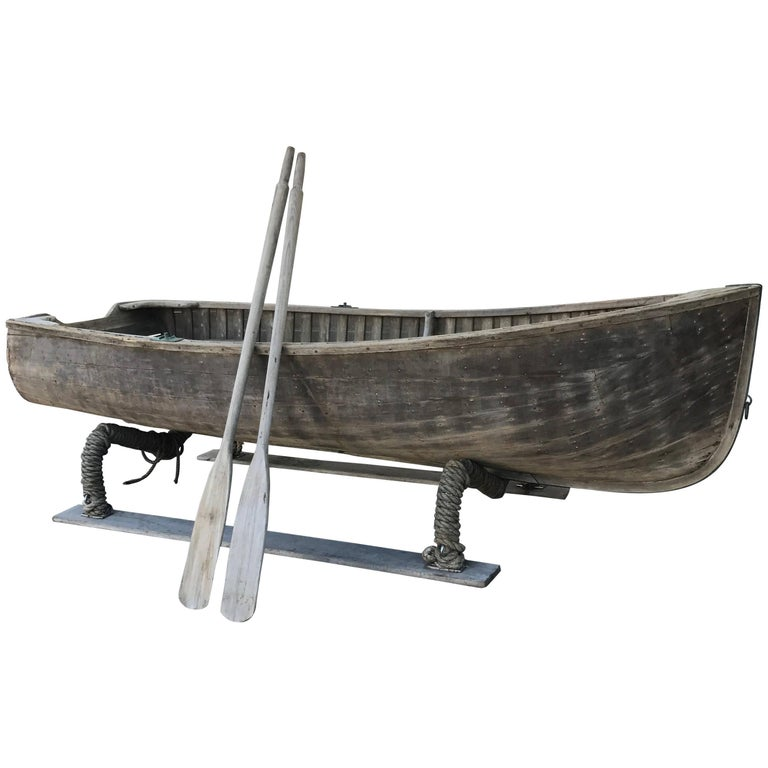 Antique Wooden Rowboat with Two Oars