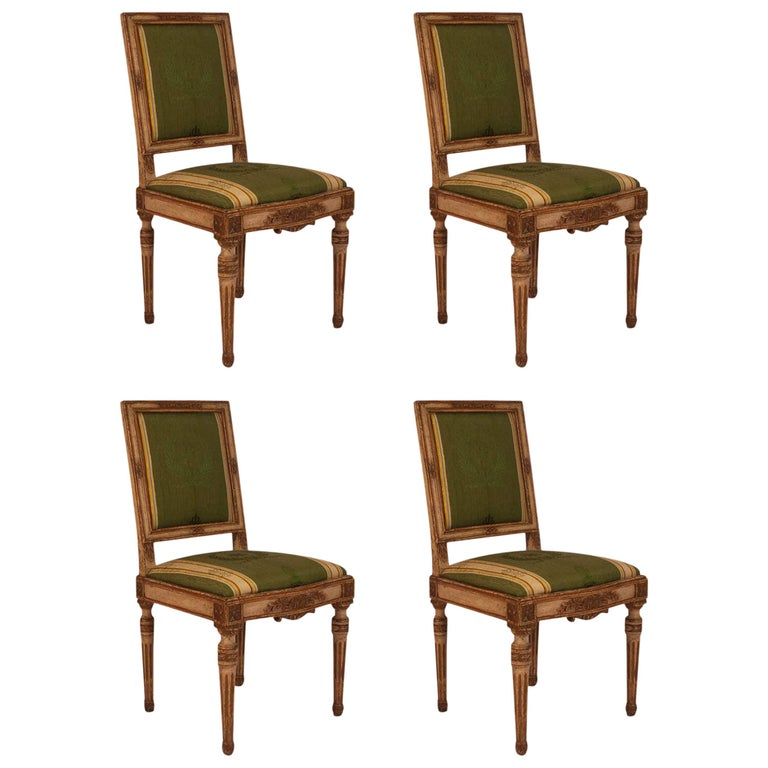 Four French Louis XVI Cream Painted and Gilt Side Chairs, circa 1780