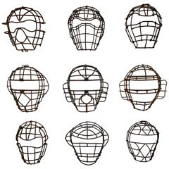 Collection of Nine Antique Steel Catchers Masks, circa 1920-1950