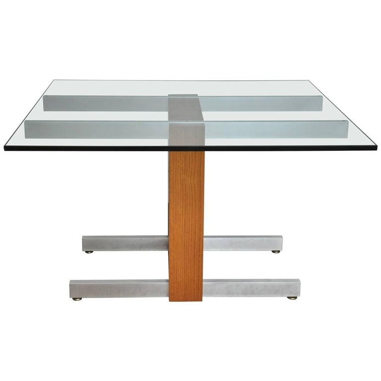 "We are proud to offer this vintage 1970 Cubist dining table. Aluminum legs, and stretcher, plate glass top (3/4""), with rare oakwood frame and l2 24"" leaves. Excellent original condition, with Kagan label. Also great to be used a s a desk."
