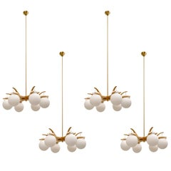 Set of Four Oak and Brass Chandeliers by Luxus, Sweden, 1960s
