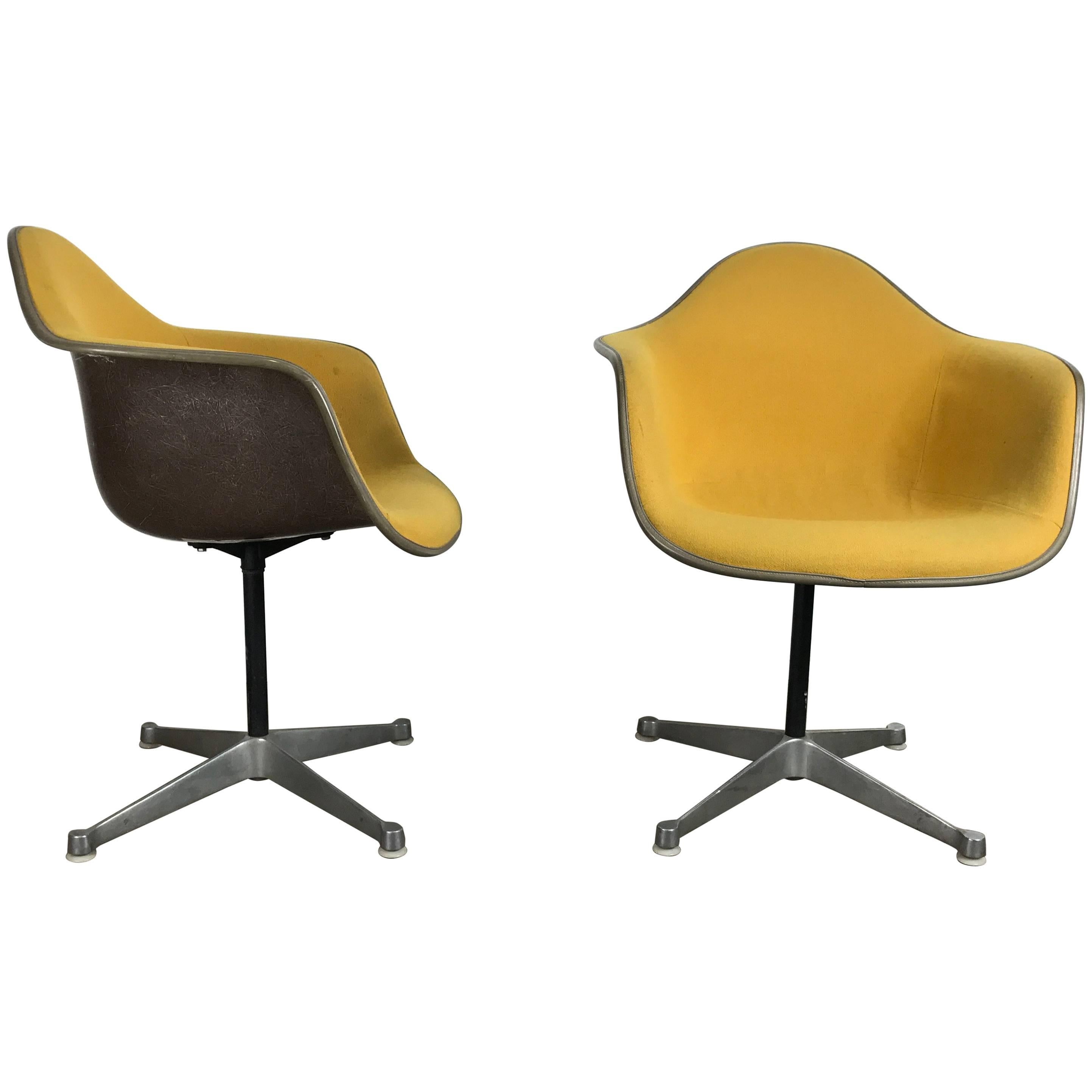 Pair of Charles and Ray Eames Swivel Padded Arm Shell Chairs, Two-Tone