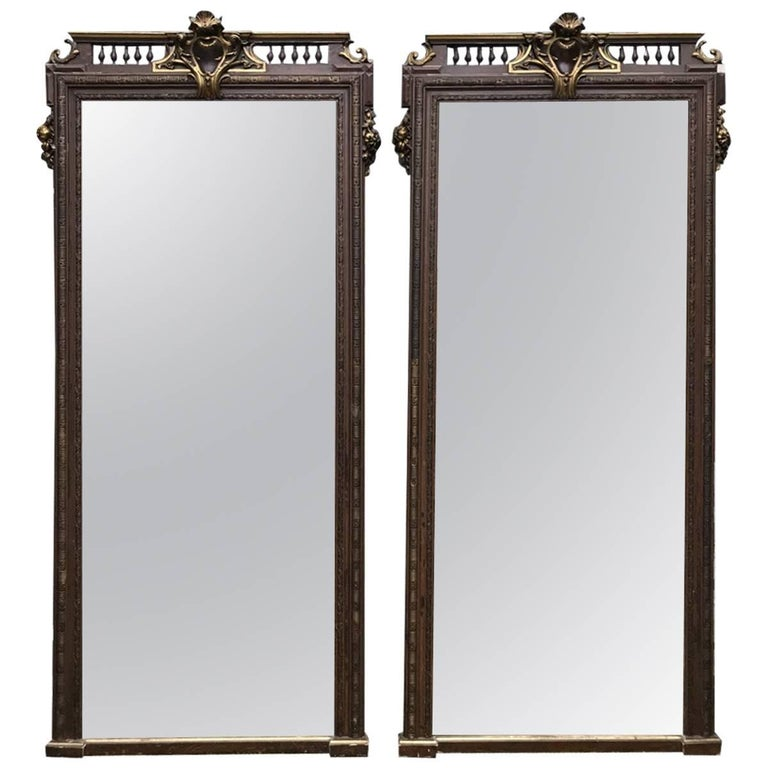 Pair of 19th Century Carved and Gesso French Mirrors with Armorial & Sunflowers