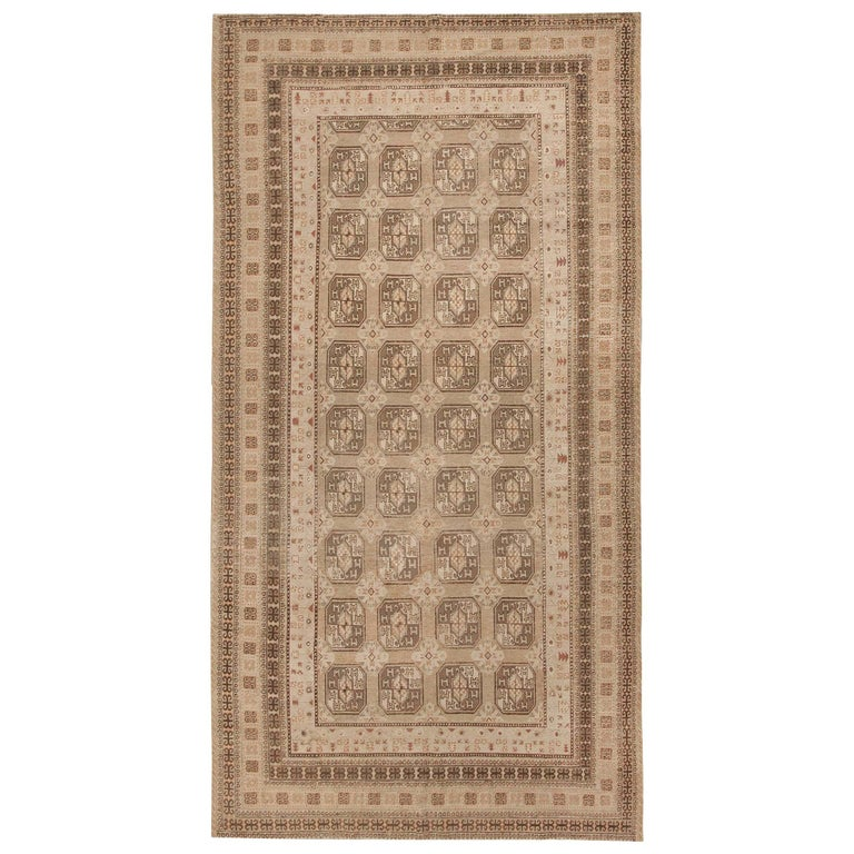 Antique Long and Narrow Oriental Khotan Rug For Sale