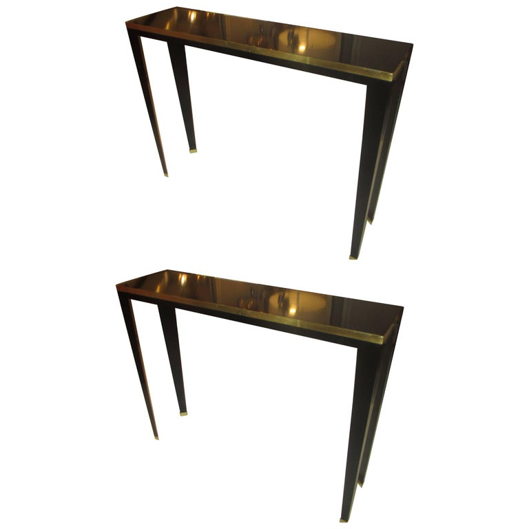 Pair of Custom Ebonized Brass-Banded Consoles on Tapered Legs