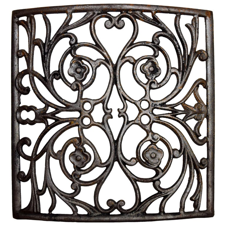 Curved Iron Heat Grate with Floral Motif, Multiple Available For Sale