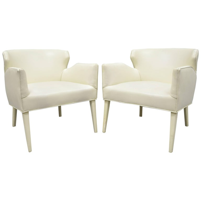 pair of barrel back sculptural off white vinyl lounge chairs after
