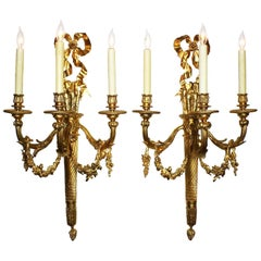 Pair of French 19th-20th Century Louis XVI Style Gilt-Bronze Torch Wall Sconces