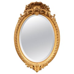 19th Century French Louis XV Oval Gold Leaf Beveled Mirror with Carved Shell