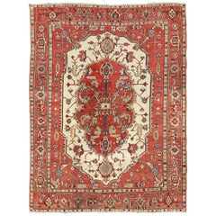 Bright Red Antique Persian Serapi Rug with Central Medallion Design in Cream