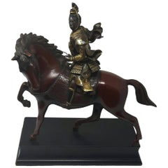 Gilt Bronze Figure of a Warrior on Horse Back