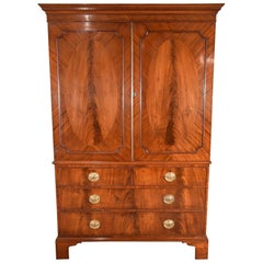 George III Mahogany Linen Press with Oval Flamed Panels