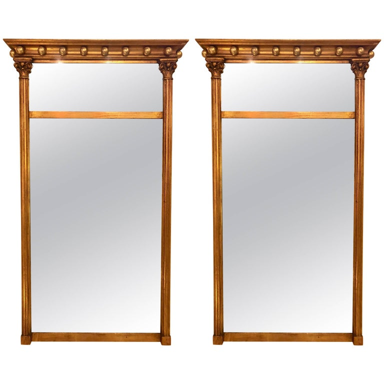 Pair of Gilt Gold Wall or Console Mirrors with Column Form Sides and Carved Tops