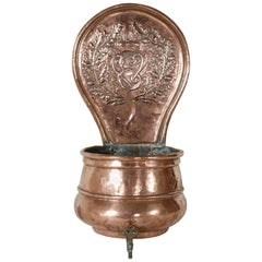 Late 18th Century Copper Repoussé Fountain with Monogrammed E and Bronze Spigot