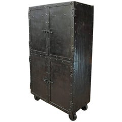 Exceptional Four-Doors Industrial Riveted Iron Cabinet on Wheels, circa 1900