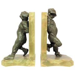 'Young Lads', Pair of Art Deco Bookends in Bronze and Onyx by Henri Molins