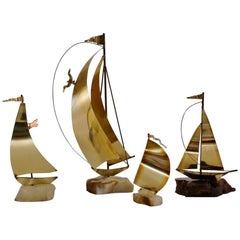 DeMott Boat Brass Sculptures, Set of Four, American, circa 1970s