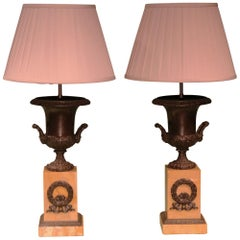 19th Century bronze urn lamps with marble bases