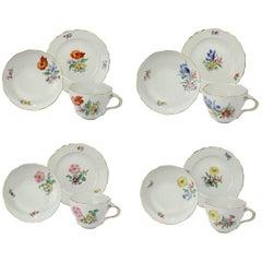 Set aus Meissener Porzellan, Teetassen, Unterteller & Teller Trios mit Blumenbildern verziert