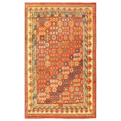Small Antique Red Background Pomegranate Khotan Rug