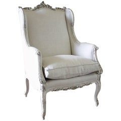 19th Century Carved and Painted Louis XV Style Wing Chair Upholstered in Linen