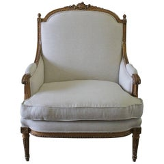 19th Century Antique Giltwood Louis XVI Style Bergere Chair Upholstered in Linen