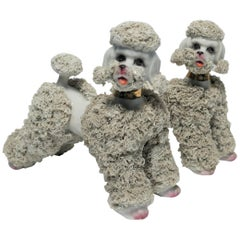 Pair of Midcentury Ceramic Porcelain Poodle Dog Sculptures