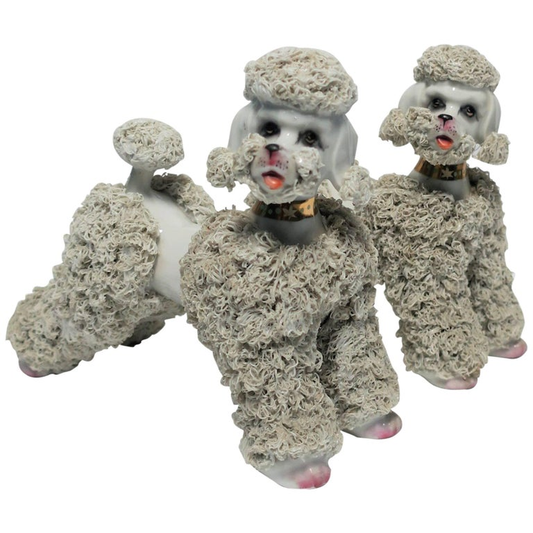 Pair of Midcentury Ceramic Porcelain Spaghetti Poodle Dog Sculptures