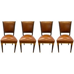 Set of Four French Carved Art Deco Brown Leather Chairs