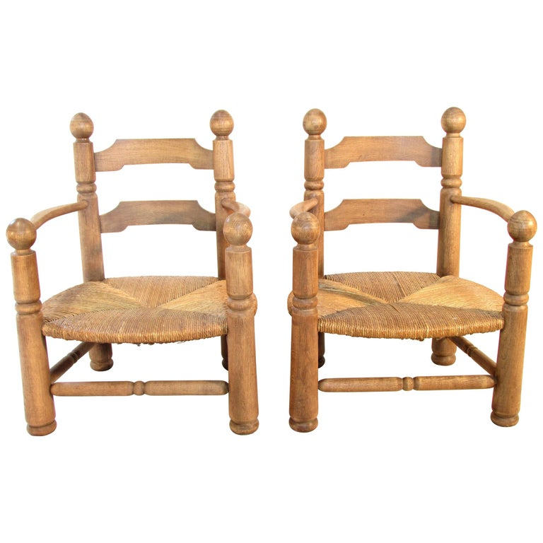 Pair of French Oak Low Fireside Chairs For Sale