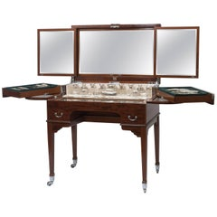 Betjeman and Sons mahogany dressing table with contents, England, circa 1911