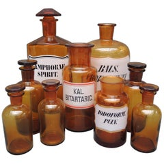 Collection of Nine Belgian Amber Glass Apothecary Bottles, circa 1890