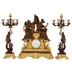 Large Gilt and Patinated Bronze Three-Piece Clock Set