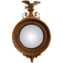 Federal Style Gilt Gold Convex Mirror Adorning a Carved Eagle