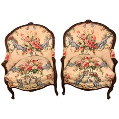 Pair of Bergère Chairs with Carved Mahogany Details and Fine Upholstery