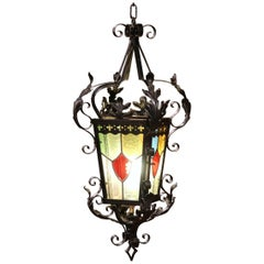 19th Century, French Napoleon III Black Iron Lantern with Stained Glass Panels