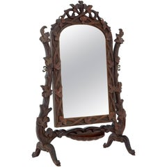 19th Century Carved Lindenwood Black Forest Vanity Mirror
