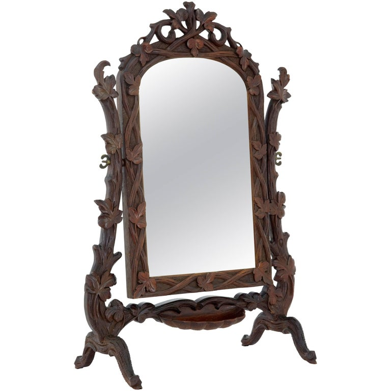 19th Century Carved Lindenwood Black Forest Vanity Mirror For Sale