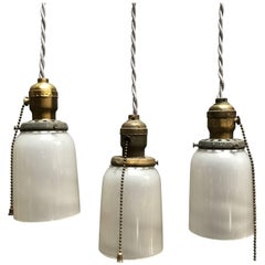 Industrial Milk Glass and Brass Pendant Lights