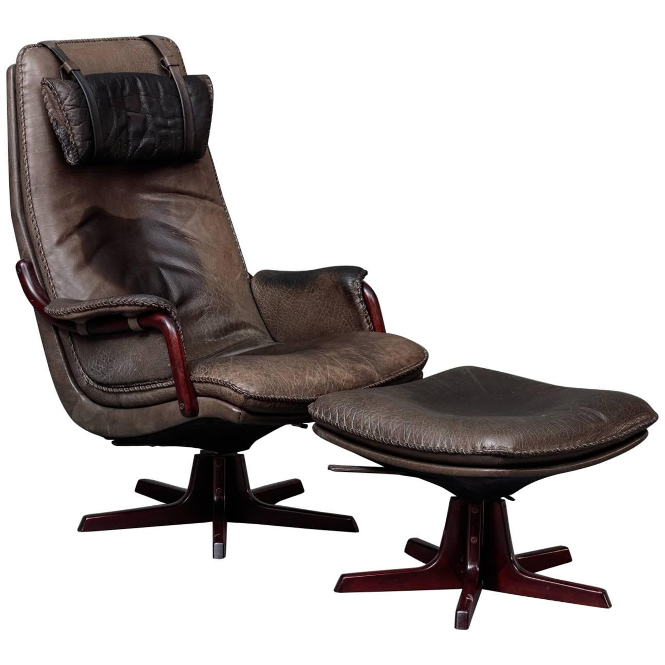 Leather and Rosewood Recliner and Ottoman