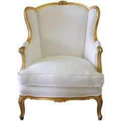 Early 20th Century Louis XV Style Giltwood Wing Chair in Belgian Linen