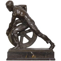 Bronze of a Man Pushing a Wheel by Ernst Seger